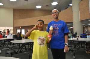 Sister and brother meeting after competition for ice cream